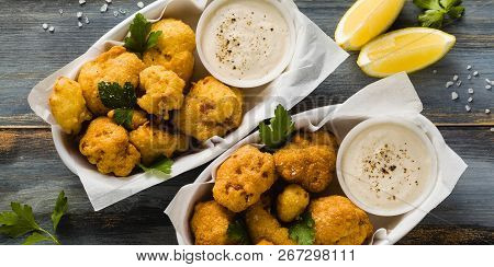 Banner Of Fried Cauliflower In Batter With A Savory Sauce Of Cashew Nuts. Healthy Vegan Fast Food. B