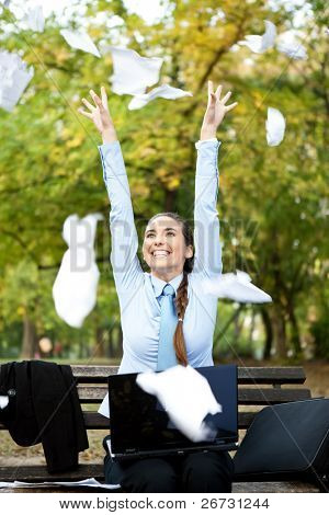 happiness businesswoman throwing paper in the air, outdoor