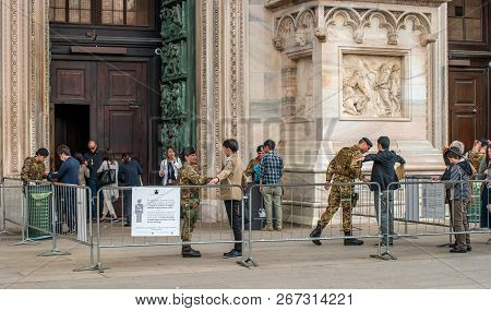 Milan, Italy - 09 May 2018: Italian Soldiers Inspect Tourists Before They Enter The Duomo. Tourists