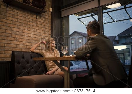 Date Of Family Couple In Romantic Relations, Love. Couple In Love At The Restaurant. Business Meetin