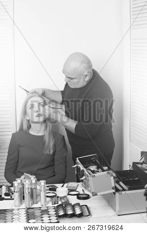 Visagiste Applying Eye Makeup On Girl Face With Brushes. Woman, Pretty Fashionable Model With Long B
