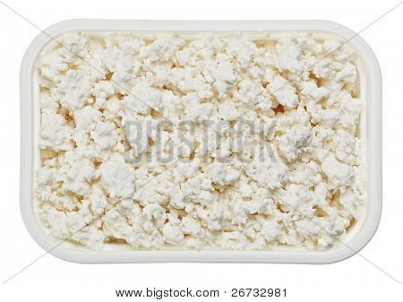 Cottage cheese (curd) in small square plate, isolated on white