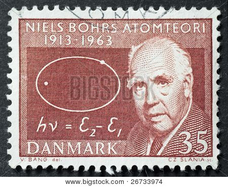 DENMARK - CIRCA 1963: a stamp printed in Denmark shows image of Niels Bohr, celebrating the fiftieth anniversary of his famous atomic theory