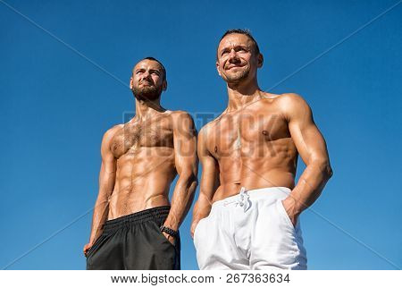 Men Sexy Muscular Bare Torso Stand Outdoor. Men Muscular Body Posing Confidently With Hands In Pocke