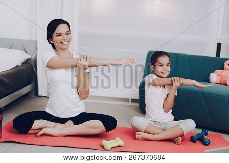 Mother Training With Daughter. Family At Home Training Beautiful Girl At Home. Beautiful Body. Train