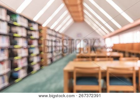 School Library Or Study Class Room, Education Blur Background With Blurry View Of Books On Bookshelv