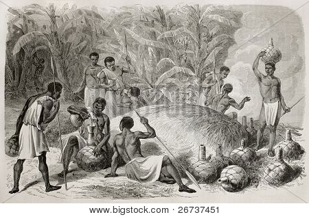 Old illustration of African indigenous drinking millet beer. Created by Bayard and Huyot, published on Le Tour du Monde, Paris, 1864
