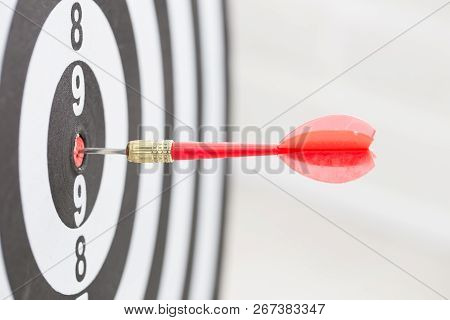 Target Dart Arrow Hitting In The Center Of Dartboard