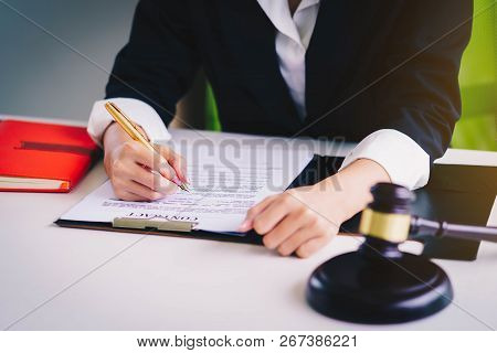 Professional Female Lawyers Working At The Law Firms. Judge Gavel. Legal Law, Lawyer, Advice And Jus