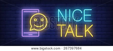 Nice Talk Neon Sign. Glowing Inscription With Mobile Screen And Emoticon On Dark Blue Brick Backgrou