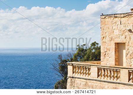 Balcony Of A Rural Villa Looking Onto The Blue Mediterranean Sea