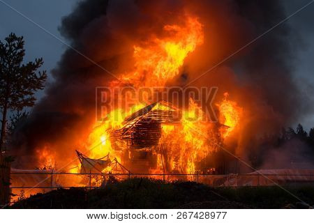A Large Abandoned One-story Wooden House Ignited And Burned. The Structure Of The Log. High Powerful