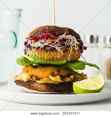 Gluten-free Vegan Burger Made From Portobello Mushrooms With Cutlets From Potato And Chickpea Flour