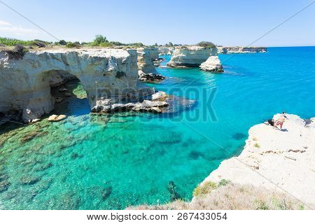 Sant Andrea, Apulia, Italy - May 30, 2017 - Tourists At The Coast Line Of Sant Andrea In Italy