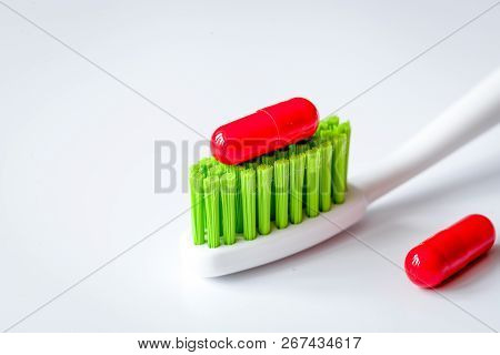 Concept Toothache With Toothbrush And Tablet At White Background