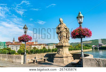 St. Frederick of Utrecht on Alte Mainbrucke, the old bridge across the Main river in Wurzburg - Bavaria, Germany poster