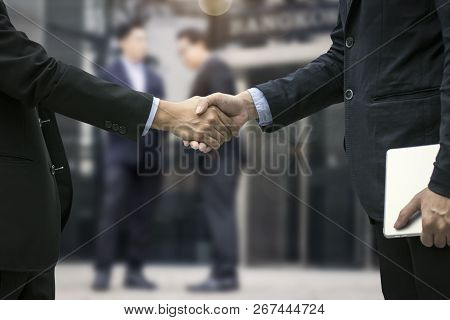 Successful Negotiating Business Concept, Close Up Hand Of Businessmen Shaking Hands After Finishing