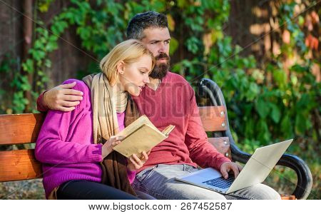 Couple With Book And Laptop Search Information. Share Or Exchange Information Knowledge. Man And Wom