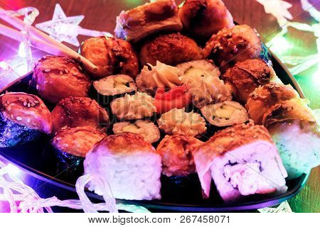 New Year And Christmas Sushi. Beautiful Food Photo With Christmas Garland.