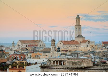 Cityscape Of Bari At Sunset With Basilica Of San Nicola And Romanic Cathedral