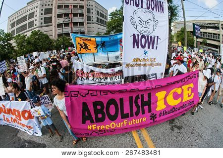 Atlanta, Ga - June 2018:  People Hold Anti-ice And Anti-trump Signs And Banners As They Line Up To T