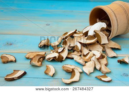 Dried Mushrooms, On A Blue Wooden Table