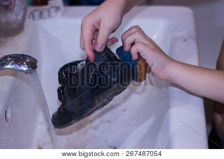 White wash in which hands wash dirty shoes poster