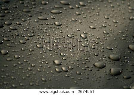 Resting Rain Droplets On Heavily Waxed Car