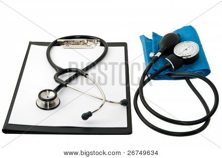 blank clipboard with medical stethoscope and blood pressure monitor isolated on white. Shallow depth of field. Focus on the center of the composition.