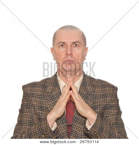 A businessman holding his hands. Isolated on white. Body language. Superiority.