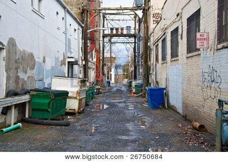 Looking down a long dark back alley.