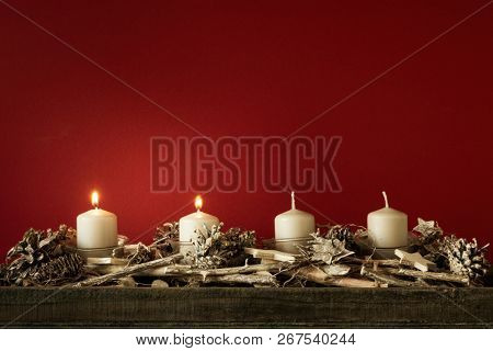 Advent time two candles burning with red background for your content