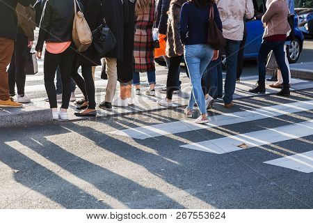Crowd Of People Crossing A Street At The Pedestrian Crossing
