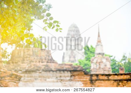 Scene Non Focus Historic Temple In Ayutthaya With Pagoda, Brick Wall ,green Tree And White Sky ,the