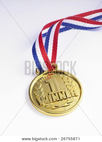 gold medal with ribbon on the white background