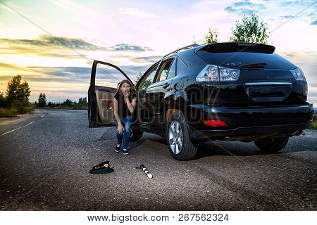 Girl Near The Car Looking With Horror At The Cap And Baton Of A Police Officer. Female Driver Hiting