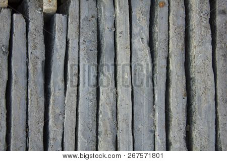 gray blue vertical uneven concrete blocks. vertical lines. rough surface texture poster