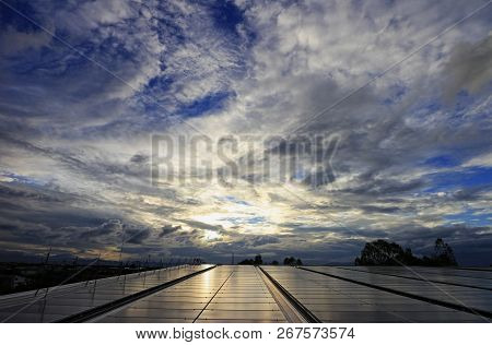 Messy Cloud Over Solar Pv Rooftop System During Sunset