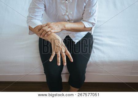 Elderly Woman Suffering With Parkinson Disease Symptoms