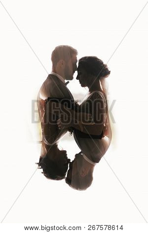 Gorgeous Bride And Stylish Groom Silhouettes Gently Hugging. Double Exposure Of Sensual Wedding Coup