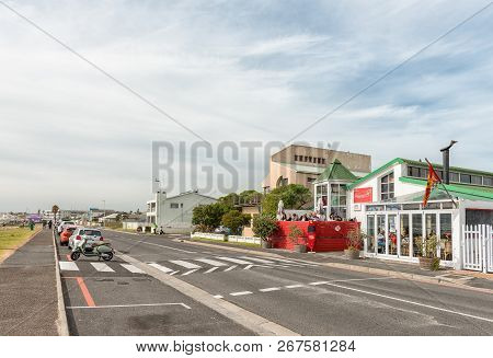 Melkbosstrand, South Africa, August 19, 2018: A Street Scene, With Restaurant, Vehicles And People,