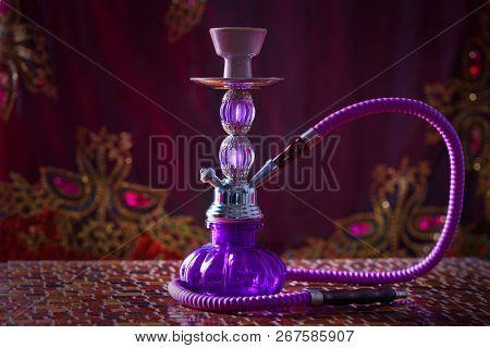 hookah smoking pipe also called shisha smoke purple glass