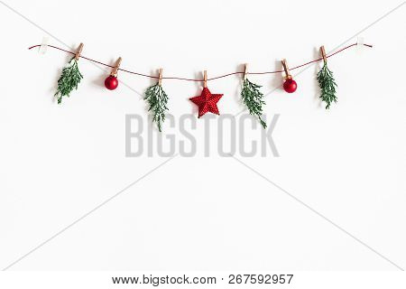 Christmas Composition. Garland Made Of Red Balls And Fir Tree Branches On White Background. Christma