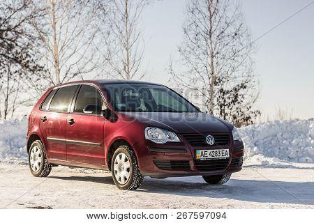 Dnipropetrovsk Region, Ukraine - February 03, 2014: Volkswagen Polo Burgundy Color On The Winter Roa