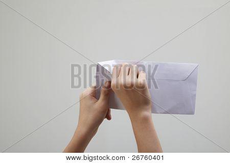 man open a white envelope