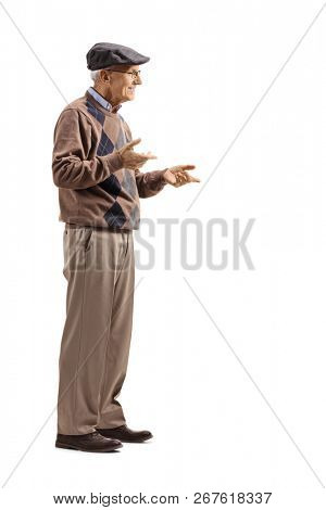 Full length shot of a senior man standing alone and gesticulating conversation isolated on white background