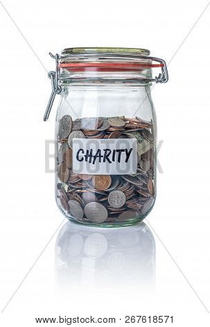 Isolated Jar Filled With Coins Labeled Charity