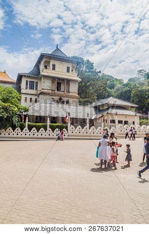 Kandy, Sri Lanka - July 19, 2016: Mostly White Clothed Buddhist Devotees In Front Oftemple Of The Sa