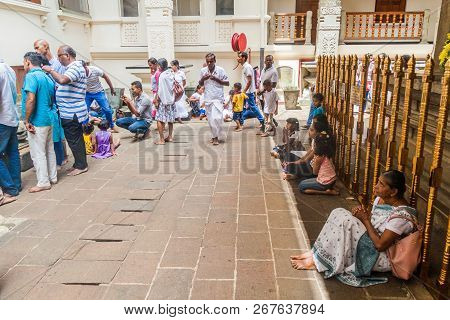 Kandy, Sri Lanka - July 19, 2016: White Clothed Buddhist Devotees Pray In The Temple Of Sacred Tooth