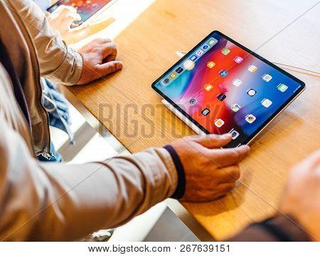 Paris, France - Nov 7, 2018: Senior Customer Experiencing New Apple Ipad Pro Tablet With Face Id, Ne